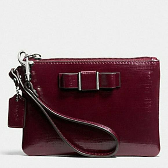 Coach Handbags - EUC COACH crossgrain leather Darcy Bow Wristlet